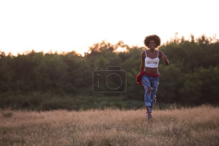 Young black woman in nature