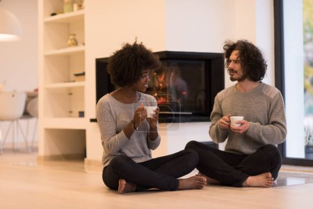 Multiethnic couple  in front of fireplace