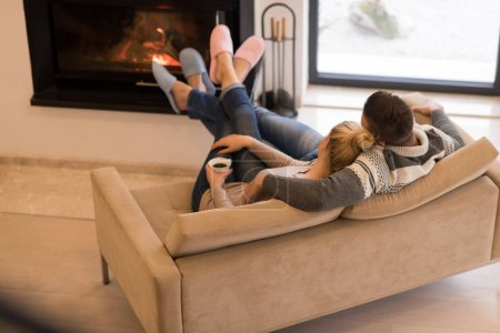 Young couple  in front of fireplace