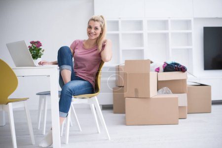 Young woman moving in a new home