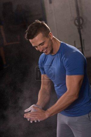 man using Gym Chalk