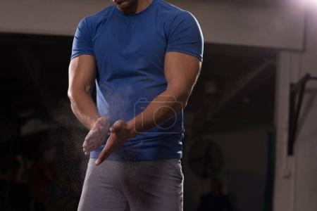 man using Gym Chalk