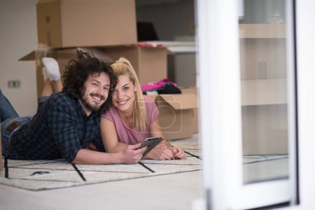 Young couple moving in new flat