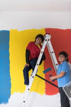 boys painting wall