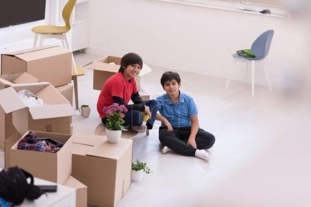 boys with cardboard boxes around them