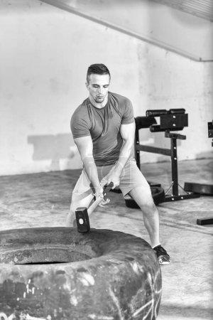 Young muscular workouting man
