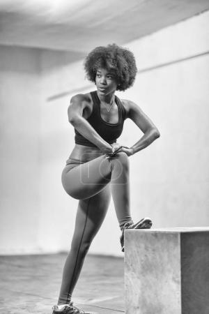 black woman are preparing for box jumps at gym