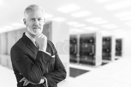 Senior businessman in server room