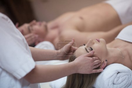 couple enjoying head massage at the spa