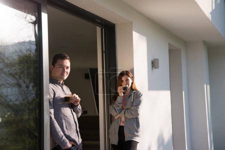 couple enjoying on the door of their luxury home villa
