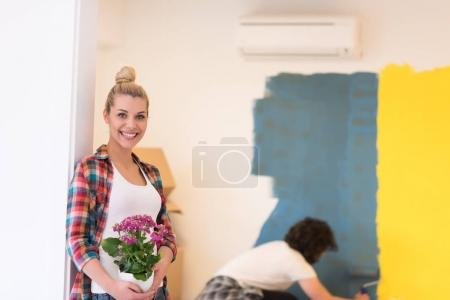 Happy young couple doing home renovations