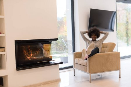 black woman in front of fireplace