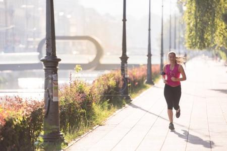 woman jogging at sunny morning