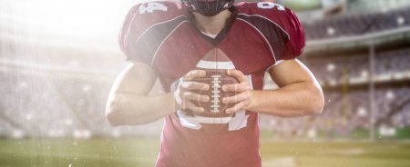 closeup American Football Player isolated on big modern stadium