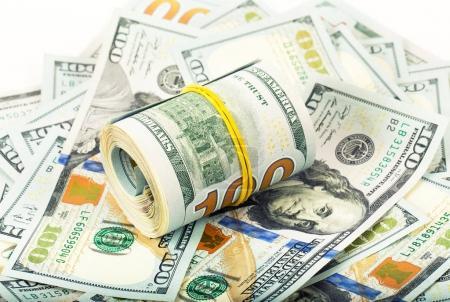 Foto de Primer plano rollo de dólares en fondo de dinero - Imagen libre de derechos