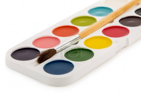 colored paints box with brush