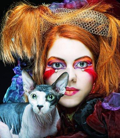 Yong princess with cat. creative fantasy make-up....