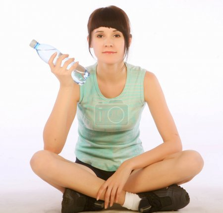 sporty woman with mineral water