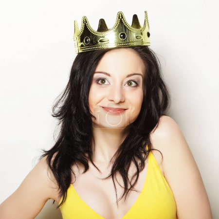 pretty brunette woman wearing crown