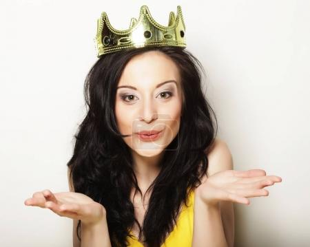 lifestyle, people and emotional concept: young  woman in crown