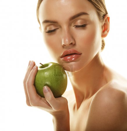 Young happy woman with green apple - isolated on white