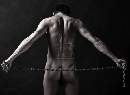 naked athlete with chain