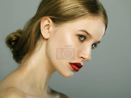 Beauty face of young woman, red lips make-up, clean skin.
