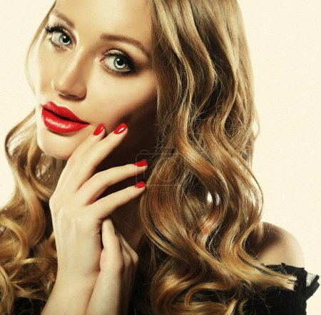 Woman with lips mouth red   lip and blonde curly hair portrait.
