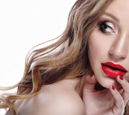 Beautiful young model woman with red lips and curly blond hair