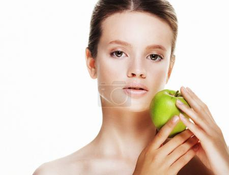 Photo for Young  woman with green apple, isolated on white background, studio shoot - Royalty Free Image