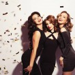 Attractive girls, cheerful best friends dancing, h...