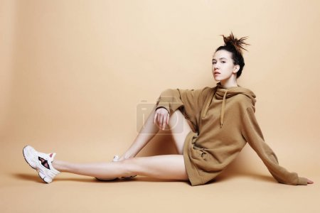 Fashion Model, Fashion, Teenage Girls. Posing over beige backgro