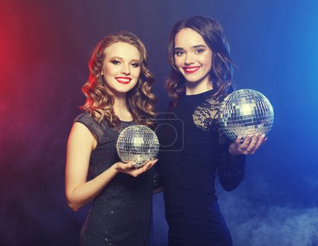 party and people concept: Party girls with disco balls