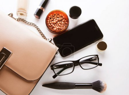 Photo for Flat lay of female fashion accessories and pink  handbag on white  background with copyspace. Beauty concept. - Royalty Free Image