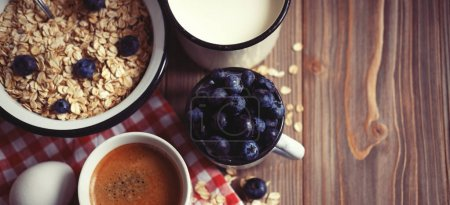 A healthy breakfast - oatmeal, boiled egg, milk, fresh berries a