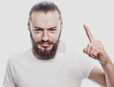 Photo for Lifestyle and people concept: Young man pointing his finger up on white background - Royalty Free Image