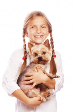 Happy girl holding her lovely yorkshire terrier dog. Isolated on white background.