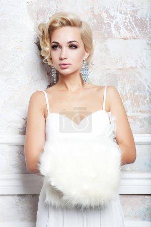 Portrait of beautiful  blonde bride in wedding dress