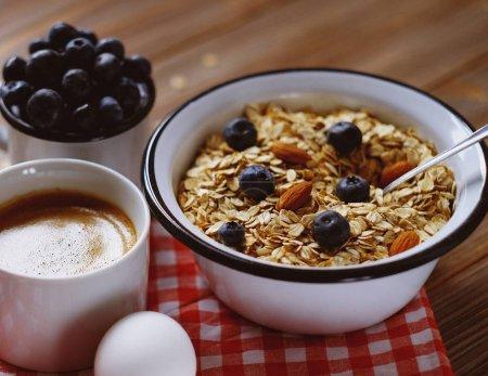 A healthy breakfast - Oatmeal porridge, boiled egg, milk, fresh berries and coffee. A great start to a new day.