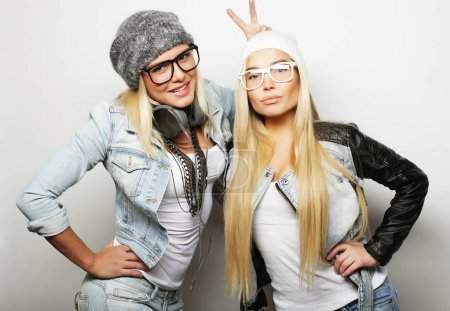 lifestyle and people concept: Two young girl friends standing together and having fun.