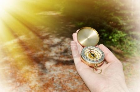 Photo for Male hand holding compass on nature background - Royalty Free Image