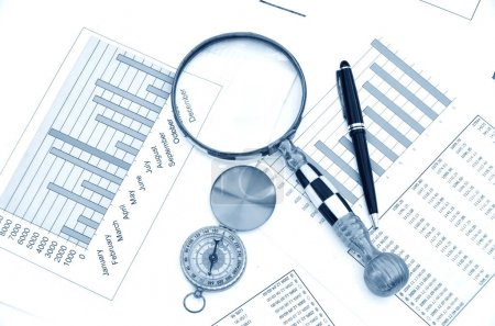 Compass and magnifying glass on the market reports