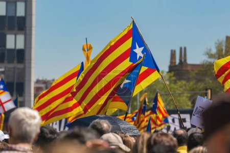 Photo for Catalan demonstrators with national catalan symbols in Barcelona to support the freedom of the political prisoners.More than 300.000 people have participated in the demonstration. 04. 16. 2018 Spain, Barcelona - Royalty Free Image