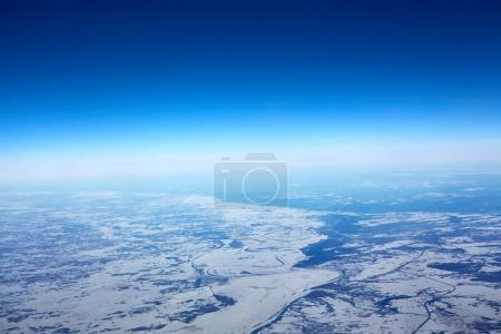 Photo for Aerial view from the plane of Siberia winter in snow - Royalty Free Image