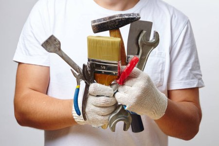 Photo for Working man holding  tools - Royalty Free Image