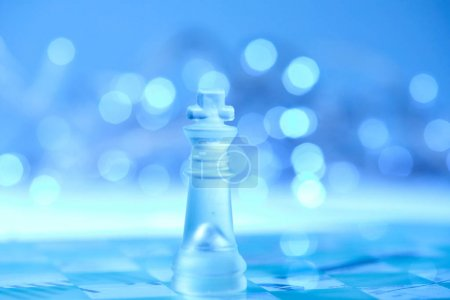 Photo for Blue glass chess on blurred background - Royalty Free Image