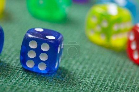 colorful Dice on green table