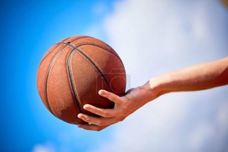 man holding basketball ball