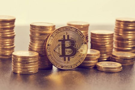 stacks of golden bitcoins