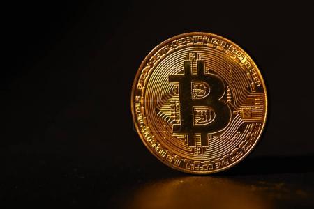 golden bitcoin on table